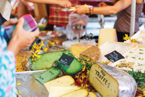 Wheels of artisan cheese at a farmer's market